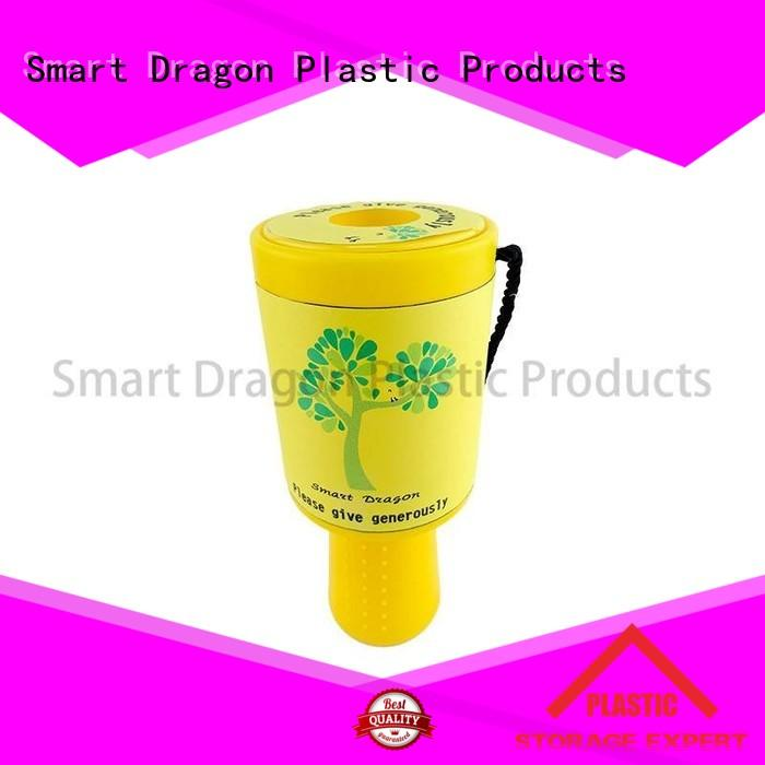 green donation box held for charity collection SMART DRAGON
